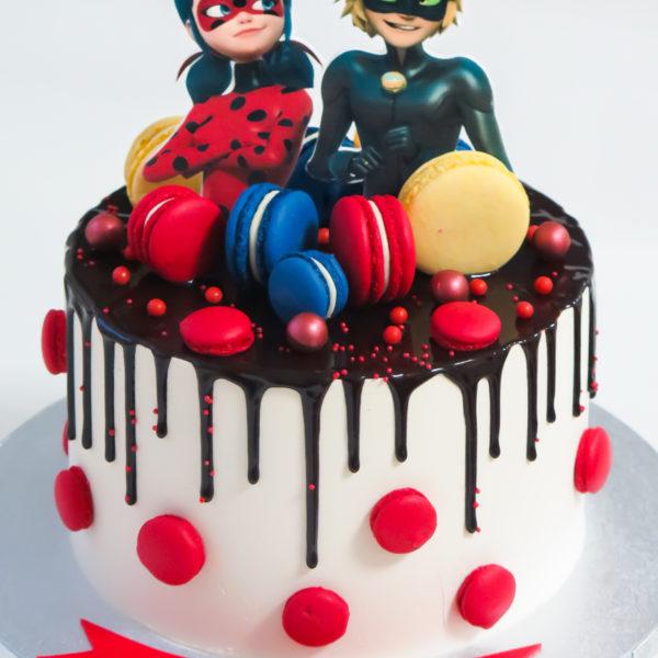 U539 - tort urodzinowy, na urodziny, dla dzieci, w kremie, bez masy cukrowej, miraculum, biedronka i czarny kot, drip, tort z dostawą, transportem warszawa, piaseczno, konstancin jeziorna, góra kalwaria, polska
